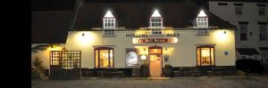 The Hill House pub in Happisburgh by night